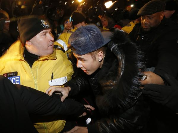 There was quite a commotion Wednesday night in Toronto when pop star Justin Bieber (center) arrived at a police station to be charged in connection with the alleged assault on a limo driver.