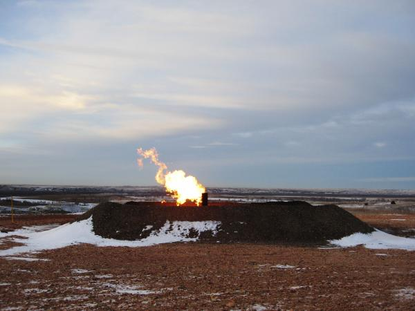 Gas flaring near Highway 85 southwest of Williston. Analysts estimate that almost 30 percent of the gas being produced in the state is burned off.