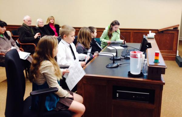 Grace Nelson (in Green) and her classmates speaking before the Government Operations and Elections committee on behalf of Palouse falls.