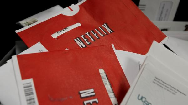 "Say goodbye to the red Netflix envelope, which the company is phasing out in favor of a new DVD delivery service called ""Qwikster."""