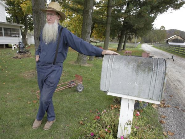 <p>Sam Mullet, father of two of the three men arrested for allegedly going into the home of other Amish and cutting their hair and beards, is seen outside his home in Bergholz, Ohio. Some who have left Mullet's community have accused him of abuse.</p>