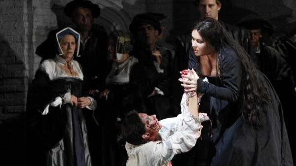 <p>Soprano Anna Netrebko, right, portrays Anne Boleyn in the Metropolitan Opera's production of <em>Anna Bolena</em> in New York. The Met raised $182 million in in donations in its last fundraising year.</p>