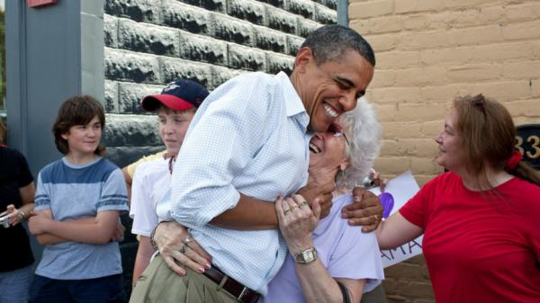 "<p>President Barack Obama greets people outside the Old Market Deli in Cannon Falls, Minn., on the Aug. 15, during a Midwest bus tour. The same day he said he likes the term ""Obamacare.""</p>"