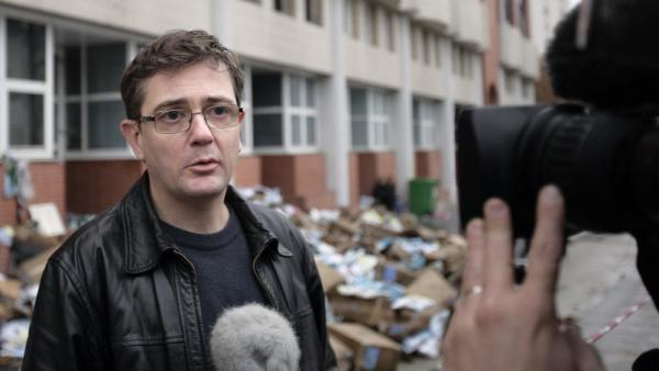 <p><em>Charlie Hebdo</em>'s publisher, known only as Charb, talked to journalists today (Nov. 2, 2011) in front of his publication's burned-out offices. </p>