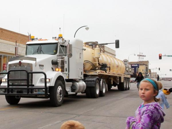 The oil industry stages events like this energy festival parade in downtown Williston in an effort to maintain good relations with the community. Industry rigs and trucks of every description roar by as drivers throw candy to the kids.