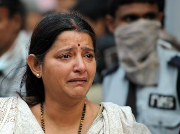 A grieving woman at the scene of today's fire in Kolkata.