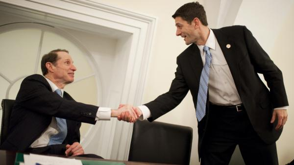 Oregon Sen. Ron Wyden, a Democrat, (left) and House Budget Committee Chairman Paul Ryan, a Wisconsin Republican, present their plan for changing Medicare at the U.S. Capitol Thursday.