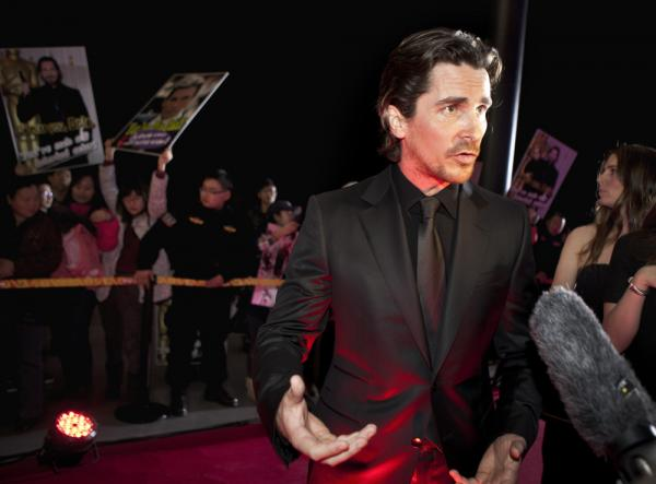 "English actor Christian Bale speaks to journalists as he arrives for an event of the Zhang Yimou-directed new movie ""The Flowers of War"" in Beijing, China."