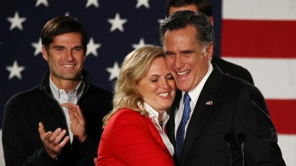 Republican presidential candidate Mitt Romney hugs his wife, Ann, in Des Moines, Iowa.
