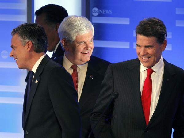 Former Utah Gov. Jon Huntsman, former Massachusetts Gov. Mitt Romney, former House Speaker Newt Gingrich and Texas Gov. Rick Perry (left to right) take their positions after a break in a debate in Manchester, N.H., Saturday.