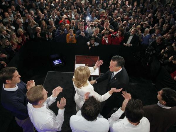 Mitt Romney reaches for his wife, Ann, as his sons, Josh, Ben, Craig, Tagg and Matt (left to right), look on during the Romney for President New Hampshire primary night rally at Southern New Hampshire University in Manchester, N.H., on Tuesday.