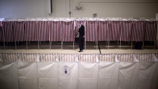 Voters cast ballots in the gym of the Webster School in Manchester, N.H., on Tuesday.