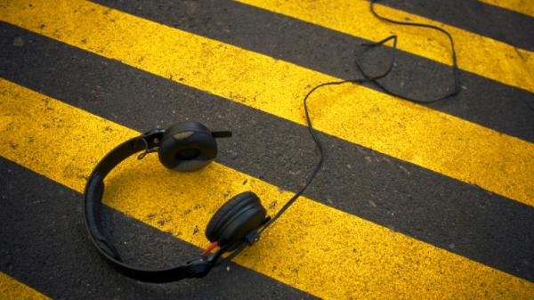 Beware of tuning out while crossing the street.