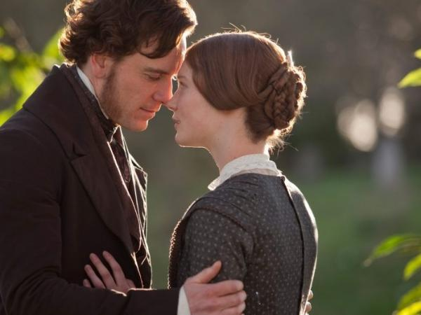 Michael Fassbender (left, with Mia Wasikowska) is Jane's employer and eventual lover, Rochester, in <em>Jane Eyre</em>.