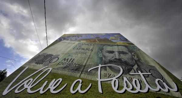 """A poster reading """"The peseta is back"""" stands in Salvaterra de Mino, northwestern Spain. Some areas in Spain are returning to their former currency to make extra cash during the debt crisis."""