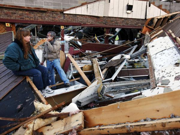 Sherry Cousins and her brother Bruce Wallace of Hollister, Mo., sit in the wreckage of their secondhand store in Branson, Mo, on February 29. A powerful storm system that produced multiple reports of tornadoes lashed the Midwest early today, roughing up the country music resort city of Branson.