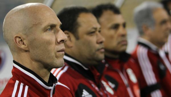 The Egyptian national soccer team's American coach, Bob Bradley, attends his team's friendly match against Kenya in the Qatari capital, Doha, in February. The Egyptian team won 5-0.