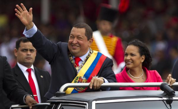 Chavez waves next to his daughter, Rosa Virginia, during a military parade in Caracas in February 2012, commemorating the 20th anniversary of the failed coup attempt that launched his political career.