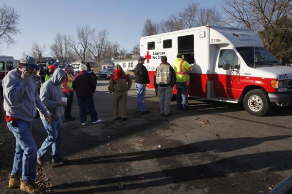 Residents and volunteers line up for food and drinks in Harveyville.