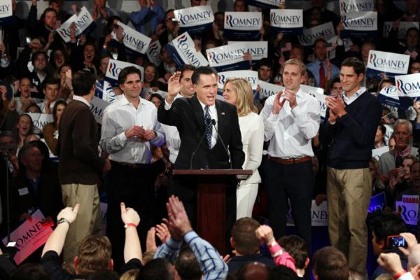 Mitt Romney speaks to supporters during a rally with members of his family, (left to right) Matt, Tagg, Craig, wife Ann, Ben and Josh Romney following the New Hampshire primary at Southern New Hampshire University in Manchester, N.H., on Tuesday evening.