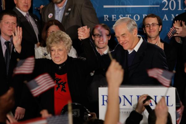 Ron Paul and his wife, Carol, wave to supporters in Manchester. Paul finished second.