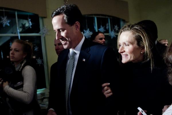 Rick Santorum and his wife, Karen, smile after speaking to supporters in Manchester. After a surge in Iowa, Santorum is fighting for fourth in New Hampshire.