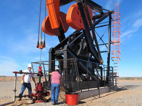 Like countries throughout the Americas, Argentina is feverishly drilling for oil and gas. Workers are shown here at a derrick in the desert in southern Argentina.
