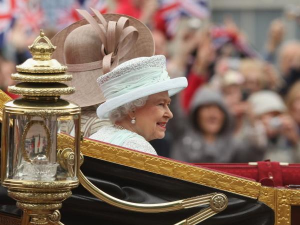 Queen Elizabeth II, as she rode toward Buckingham Palace earlier today. The Duchess of Cornwall (Camilla) rode beside her. Also in the carriage: the Prince of Wales (Charles).