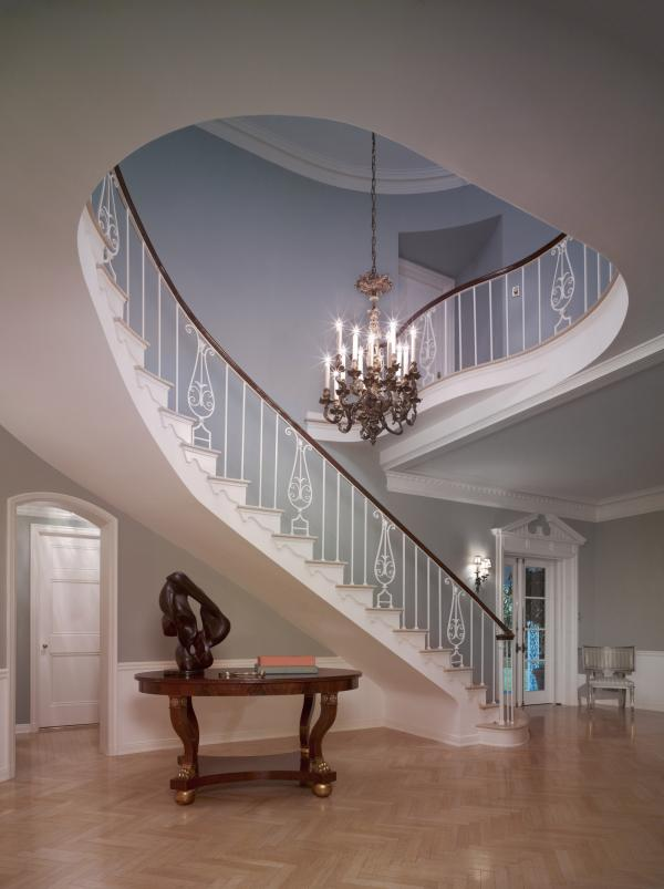 "The staircase of the French Normandy-style Sensenbrenner residence, built in Beverly Hills in 1933, features a Williams trademark cherished by his homes' owners: a beautiful, sinuously curving staircase that was the focal point of the foyer. ""He did the most beautiful entry halls I've ever seen,"" said real estate agent Bret Parsons."