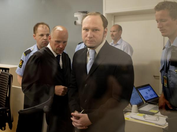 In this picture taken through bullet proof glass, mass killer Anders Behring Breivik looks on as he arrives for his trial in room 250 of Oslo's central court on June 21, 2012.