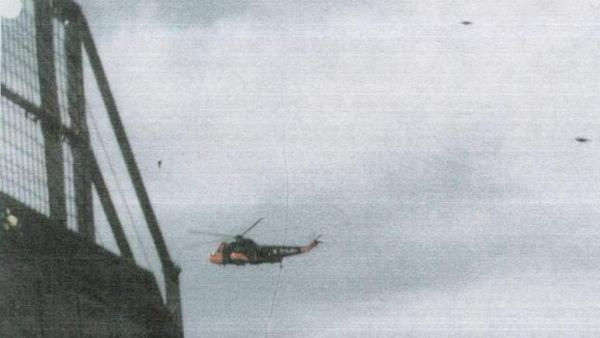 "This picture titled ""UFO near helicopter"" was released by the National Archives."