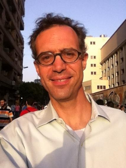 <em>New York Times</em> reporter David Kirkpatrick standing in Cairo's Tahrir Square.