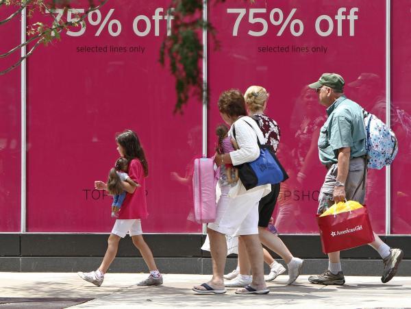 Shoppers walk along Chicago's Michigan Avenue last month.