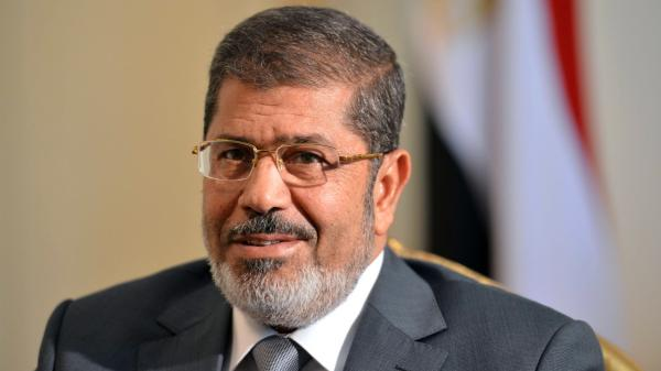 Egypt's new president, Mohammed Morsi, has promised to improve the lives of ordinary Egyptians during his first 100 days in office. But Morsi, shown here in July, is dealing with multiple challenges, including an economy that has been struggling since last year's revolution.