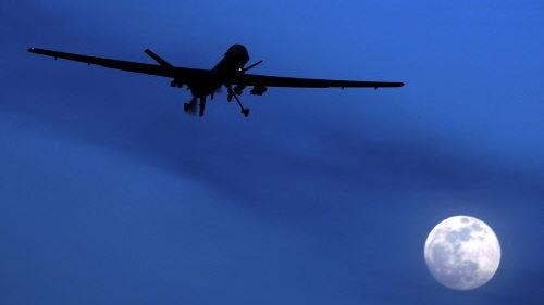 A U.S. Predator drone flies through the night sky over Kandahar Air Field in Afghanistan. Such drones have been targeting groups such as the Haqqani network that are accused of attacking U.S. and Afghan forces.