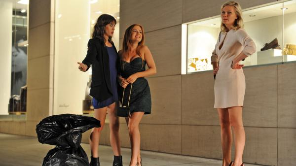 <strong>Party Animals:</strong> Lizzy Caplan (from left), Isla Fisher and Kirsten Dunst play the brazen bridesmaids who make trouble for bride-to-be Becky (Rebel Wilson) in <em>Bachelorette.</em>