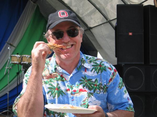 A patron enjoys the offerings at this year's Ohio Fish and Shrimp Festival.