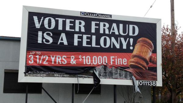 "An anonymous ""family foundation"" is paying for billboards warning against voter fraud, like this one in a minority neighborhood on the east side of Cleveland. Clear Channel, which owns the space, says the anonymity violates its policies but it will not take the ads down."