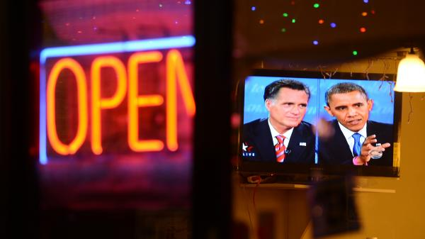 The debate between President Obama and Republican challenger Mitt Romney is seen on a TV in a Korean restaurant Oct. 22 in Los Angeles, Calif.