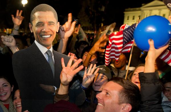 A celebration with cardboard cutout of President Obama in front of the White House early Wednesday morning.