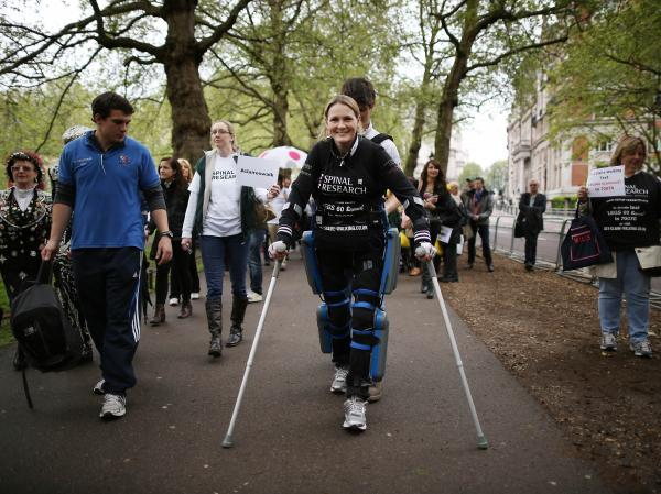 Claire Lomas walks the last mile of the London Marathon on May 8, 2012 in London, England. After a riding accident left her paralyzed from the waist down in 2007, Lomas completed the race walking 2 miles a day over 16 days with the help of a ReWalk bionic suit (by Argo Medical Technologies).