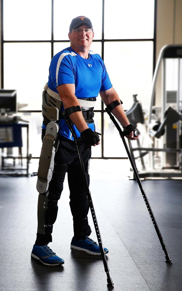 Brian Shaffer tests an exoskeleton developed by researchers at Vanderbilt University at a rehabilitation center in Franklin, Tenn. The exoskeleton locks around the legs and feet. To stand up, a paralyzed person simply leans forward.