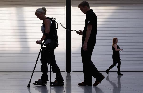 Paralyzed from the waist down, Amanda Boxtel walks with the aid of a bionic exoskeleton in London in 2011. Users learn to walk in the Ekso Bionics device with rehabilitation technicians controlling their steps before walking on their own.