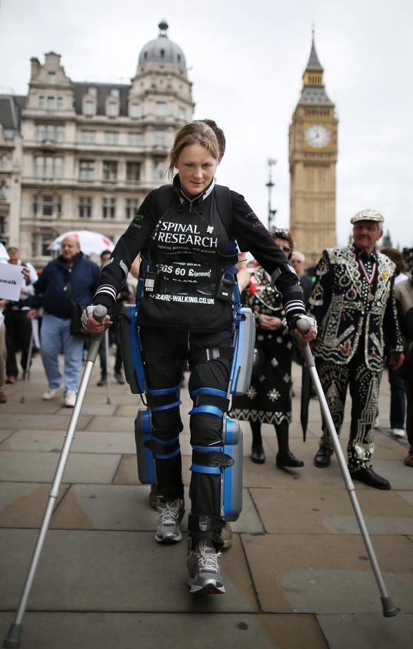 Claire Lomas, a paraplegic, walks the last mile of the London Marathon in May 2012. Starting out with 36,000 other runners, she averaged two miles a day with the help of a bionic ReWalk suit by Argo Medical Technologies.