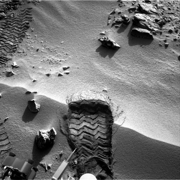 "NASA's Mars rover Curiosity cut a wheel scuff mark into a wind-formed ripple at the ""Rocknest"" site to give researchers a better opportunity to examine the particle-size distribution of the material forming the ripple. The rover's right Navigation camera took this image of the scuff mark on the mission's 57th Martian day."