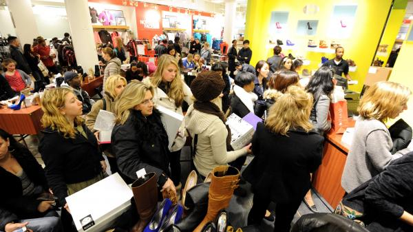 "People waited in line to make purchases at a Macy's department store in New York during last year's ""Black Friday"" shopping weekend."