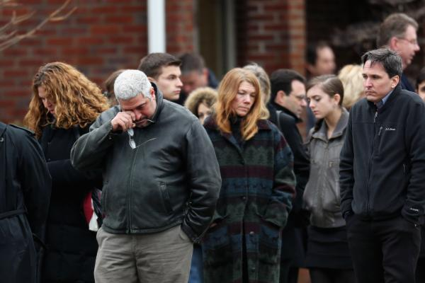 People arrive for the funeral services of Noah Pozner in Fairfield.