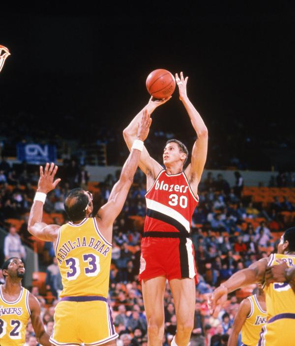Sam Bowie of the Portland Trail Blazers shoots over Kareem Abdul-Jabbar of the Los Angeles Lakers during a game circa 1984-1988 at the Great Western Forum in Inglewood, Calif. Bowie's NBA career is the subject of a new ESPN documentary airing Thursday.