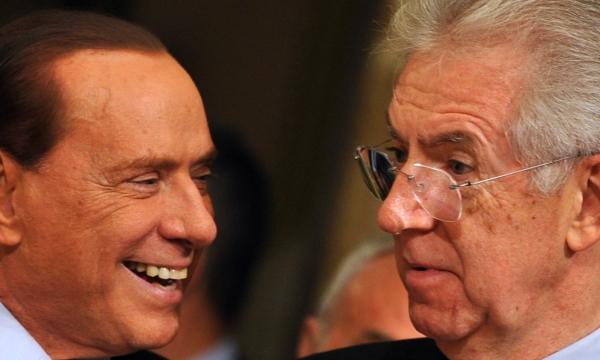 Former Prime Minister Silvio Berlusconi (left) has returned to Italy's political scene in advance of next month's election. Also in the race is the current Prime Minister Mario Monti (right). They are shown here in November 2011 as Monti took over for Berlusconi.