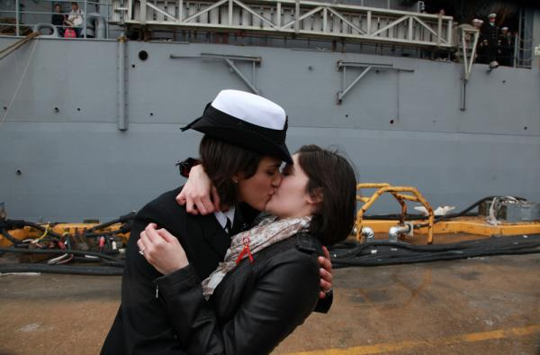 "Dec. 21, 2011: Petty Officer 2nd Class Marissa Gaeta, left, kisses her girlfriend of two years, Petty Officer 3rd Class Citlalic Snell at Joint Expeditionary Base Little Creek in Virginia Beach, Va. Gaeta's ship had returned from 80 days at sea. Their ""first kiss"" <a href=""http://n.pr/vFDwy2"">that day</a> was a first of its kind for the Navy."